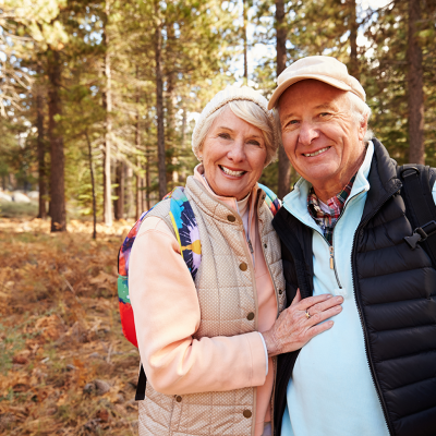 old white couple in woods